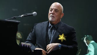 Billy Joel wears a jacket with the Star of David during the encore of his 43rd sold out show at Madison Square Garden on August 21.