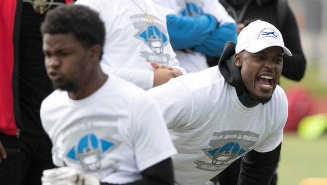 Detroit Lions linebacker Tahir Whitehead works with young players during the Calvin Johnson Jr. Foundation Catch a Dream football camp held at Southfield high school Saturday, May 20, 2017 in Southfield.