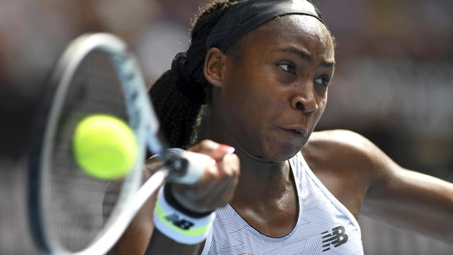 Coco Gauff of the U.S. makes a forehand return to compatriot Sofia Kenin during their fourth round singles match at the Australian Open tennis championship in Melbourne, Australia, Sunday, Jan. 26, 2020.