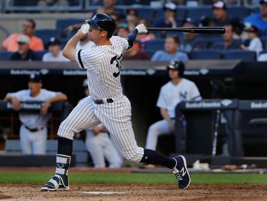 New York Yankees' Greg Bird (33) connects for a three-run