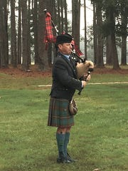 "Sean McCartney plays ""Amazing Grace"" during a Veterans"
