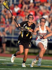 HF-L's Brittany Chamberlain, left, is defended by Pal-Mac's