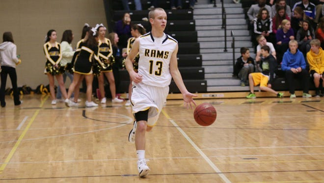 Southeast Polk's Sam Henry brings the ball down the court on Tuesday, Feb. 3, 2015 at Southeast Polk High School. Southeast Polk faced Dowling in a boys and girls doubleheader.