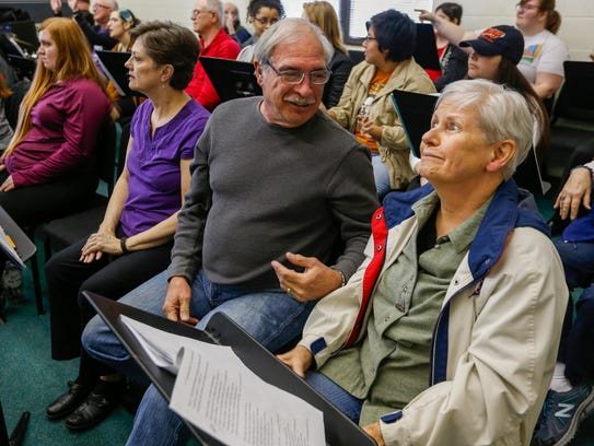 Judy Folkins, right, reacts to something Don Mihalevich