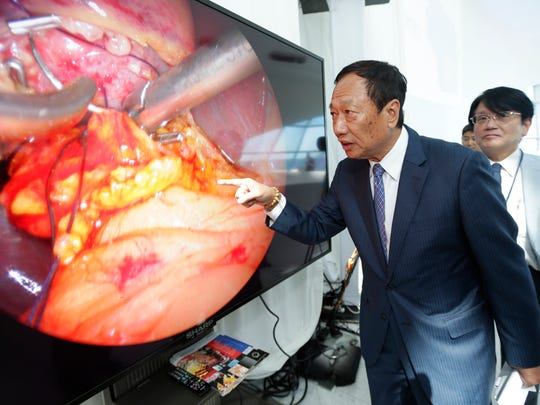Foxconn Chairman Terry Gou shows off the 8K screen