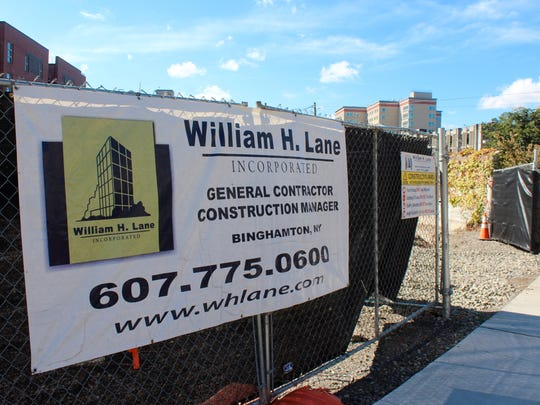 The entrance to the construction site of the upcoming Hilton Canopy Hotel at 320 E. State St.