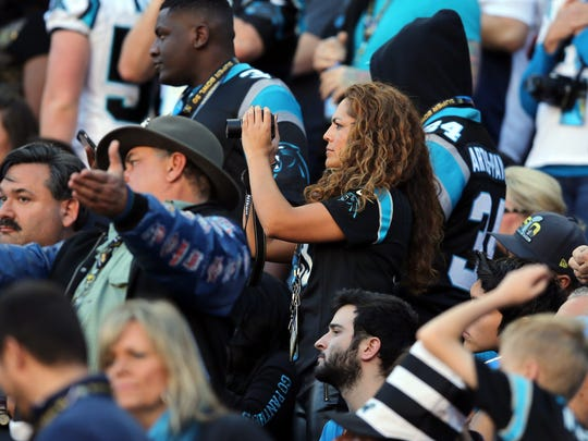 Feb 7, 2016; Santa Clara, CA, USA; Iris De Hoyos, the mother of Carolina Panthers free safety Tre Boston (33) takes photos from the stands prior to Super Bowl 50 against the Denver Broncos at Levi's Stadium. Mandatory Credit: Kelley L Cox-USA TODAY Sports