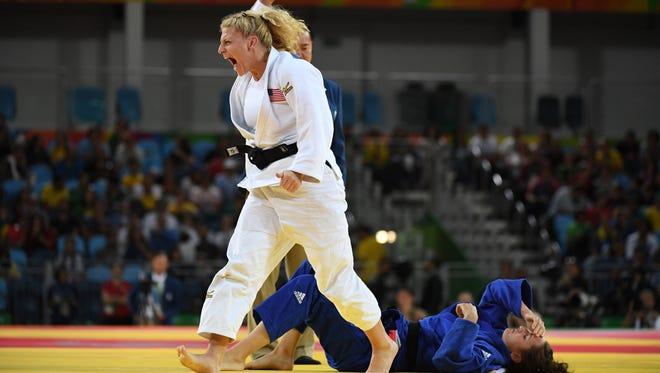 Kayla Harrison celebrates after beating Abigel Joo.