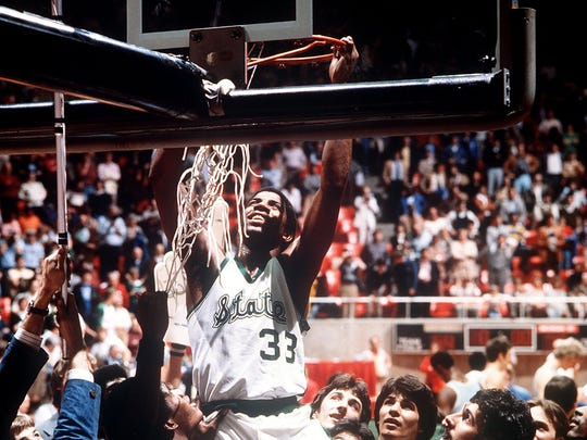 "Michigan State's Earvin ""Magic"" Johnson (33) cuts down"