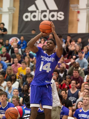 Malik Newman participates in the Powerade Jam Fest on Monday, March 30.