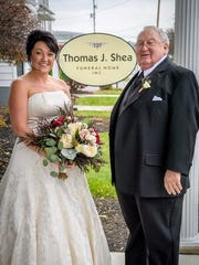 Jennifer Sullivan, left, with her father, Michael Meagher, at their family's funeral home on her wedding day.