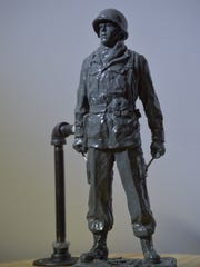 A 9-inch modello of the Harry Rockafeller statue that