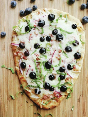 Blueberries add a sweet finish to a savory flatbread topped with mozzarella and gorgonzola cheeses and pancetta. Photo by Gretchen McKay/Pittsburgh Post-Gazette/TNS