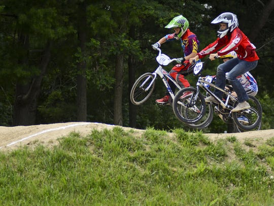 Kids race during a BMX event at Goodells County Park Sunday