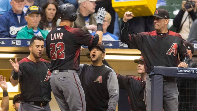 Diamondbacks third baseman Jake Lamb celebrates after hitting a home run Friday night during the fourth inning against the Brewers at Miller Park.