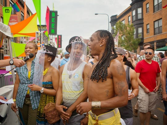 From left, Sherelle Smith, her fiancee Keela Taylor, Dakota Jackson and his fiancee Marcel Campbell participate in a mock wedding ceremony at the booth for the Lesbian and Gay Bar Association of Chicago for the Northalsted Market Days on Aug. 10, 2014.