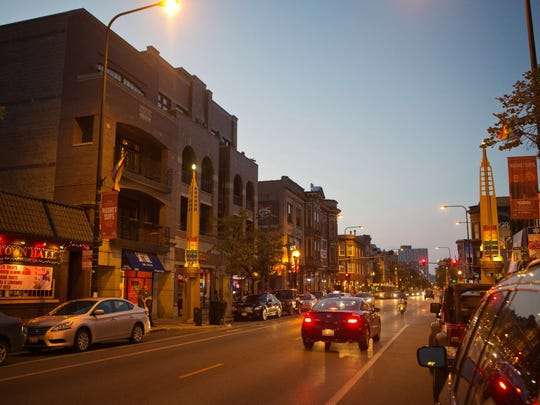 Cars travel along North Halsted Street at dusk in Chicago's Boystown, the nation's first municipally recognized gay village, on Aug. 7, 2014.