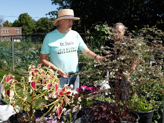 Botanist Duncan Bell shows his auto garden watering system at the Nyack Community Garden  on Saturday, September 23, 2017.