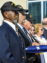 The three U.S. Marines who lowered the American flag when the U.S. embassy in Havana, Cuba, closed more than 50 years ago were on hand when the flag was raised again following the normalization of relations between the two countries. The retired Marines are, from left, Gunnery Sgt. Francis 'Mike' East, Gunnery Sgt. James Tracy and Cpl. Larry Morris