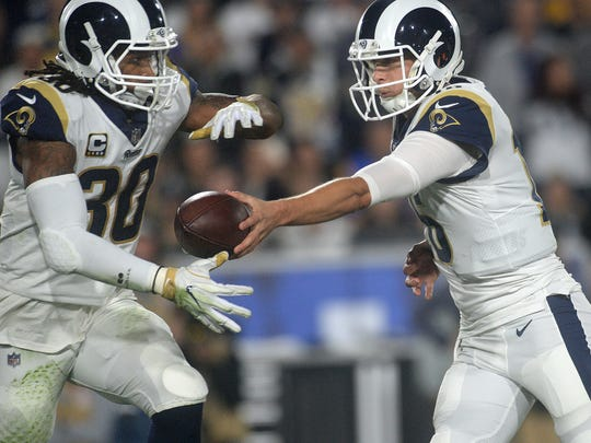 Rams running back Todd Gurley, left, takes a handoff from Rams QB Jared Goff against the Falcons in the first half of an NFC wild-card game at the Coliseum. The Rams were knocked out of the playoffs with a dissapointing 26-13 loss.