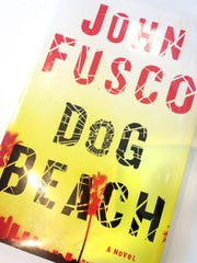 "John Fusco's new novel ""Dog Beach"" follows the exploits of Louie Mo, once Hong Kong's greatest stuntman turned Los Angeles knee-breaker, as his latest target unexpectedly casts him in the role of a lifetime."