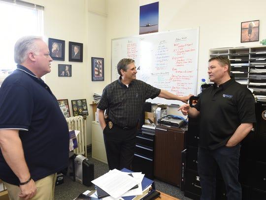 Lt. Jack Allen, center, visits with Jake Liudahl, right,