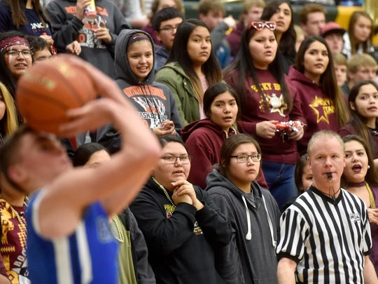 Fans from Rocky Boy look on during a past postseason contest at C.M. Russell High. The Northern Native American Basketball Classic comes to CMR this Friday and Saturday, featuring nine Native American schools from Montana and one from Canada.