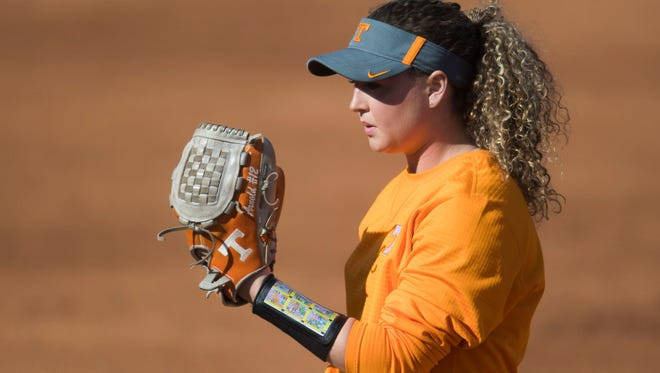 Caylan Arnold prepares to throw a pitch during University of Tennessee softball practice Wednesday, Jan. 31, 2018.