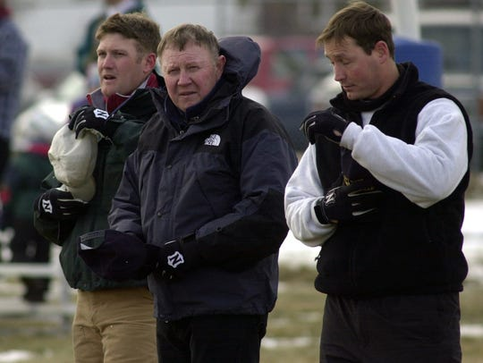 Ron Kowalski, center, was head football coach at Cut