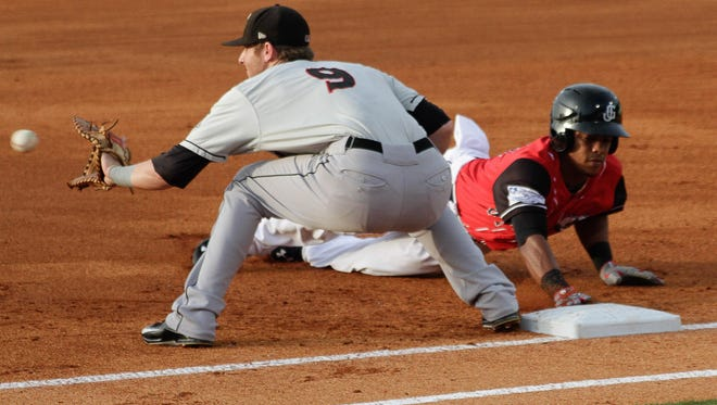 Ketel Marte of the Jackson Generals slides into first Friday as the Generals take on the Birmingham Barons.
