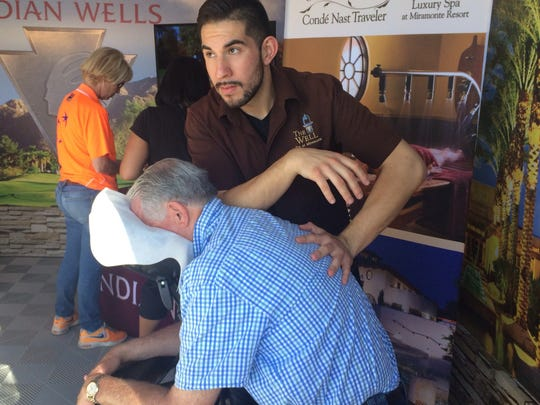 Employees from The Well Spa at Miramonte Resort & Spa give out free massages at the Indian Wells Tennis Garden.