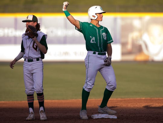 Wall's Dryden Virden celebrates after hitting a double
