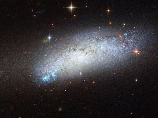 This galaxy goes by the name of ESO 162-17 and is located about 40 million light-years away in the constellation of Carina.