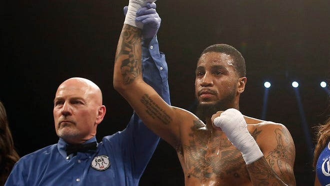 Dominic Wade  celebrates after his victory against Marcus Upshaw  in April at the D.C. Armory.