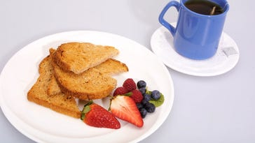 A healthy breakfast of toast, fruit and tea. ---