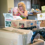 Erna Pontillo unpacks her belongings after a two month delay from her moving company at her home in Gilbert on Wednesday, June 11, 2014.
