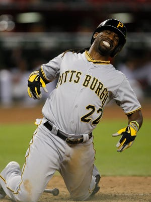 Aug 2, 2014: Pittsburgh Pirates center fielder Andrew McCutchen (22) reacts after getting hit with a pitch in the ninth inning against the Arizona Diamondbacks at Chase Field.