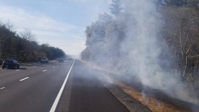 A series of fires were lit along I-195 between New Bedford and Westport on Tuesday afternoon, according to a Facebook post by the Dartmouth Police Department.