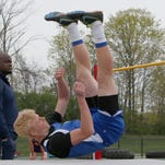 Simon Kenton High school student Logan Winkler competes in the Boys High Jump during NKAC Division I track championship at Scott High School Tuesday April 23, 2013 in Taylor Mill, Ky.