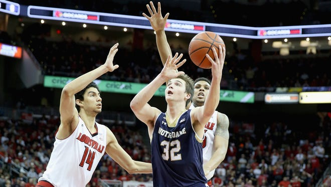 Steve Vasturia #32 of the Notre Dame Fighting Irish shoots the ball during the game against the Louisville Cardinals at KFC YUM! Center on March 4, 2015 in Louisville, Kentucky.