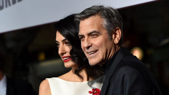 George and Amal Clooney are officially jet-set parents.