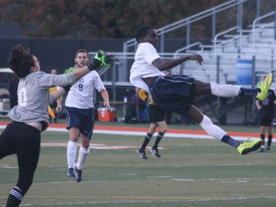 Franklin's Jordan Whitt watches his header bounce into the net to give the Patriots a 2-0 lead early in the second half.