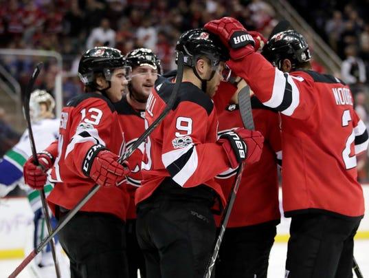636473015262488252-Canucks-Devils-Hockey-njha-1-.jpg