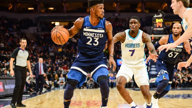 Minnesota Timberwolves guard Jimmy Butler (23) controls the ball while defended by Charlotte Hornets forward Dwayne Bacon (7) during the third quarter at Target Center. The Timberwolves won 112-94.