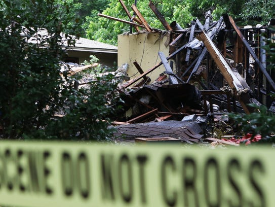 A home at 1303 South Eighth Street in Monroe exploded