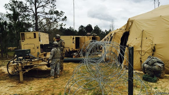 2) Soldiers from 1st Brigade set up generators and