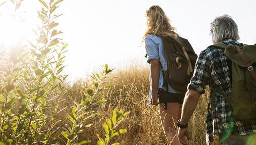 Couple hiking with rucksacks