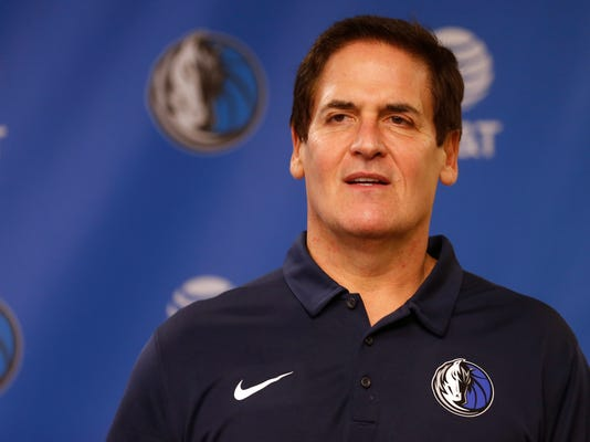 Dallas Mavericks owner Mark Cuban stands on stage before Cynthia Marshall, new interim CEO of the team, is introduced during a news conference, Monday, Feb. 26, 2018, in Dallas. (AP Photo/Ron Jenkins)