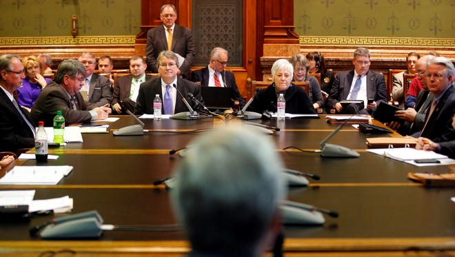 University of Iowa President Sally Mason and AIB Board of Trustees President Chris Costa take questions from the House Appropriations Committee at the Capitol Monday, February 9, 2015.
