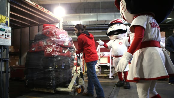 Dustin Bradds, a GABP clubhouse attendant, helps load crates of equipment onto a trailer that is bound for Goodyear, Ariz.